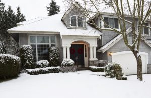 home exterior covered in snow in need of home repairs
